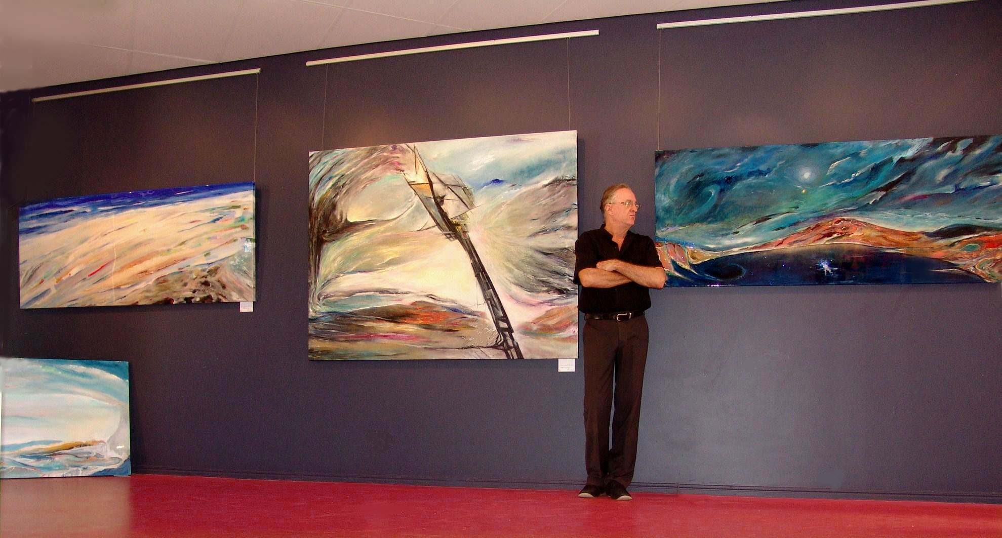 Christopher de Lisle with some of his art.